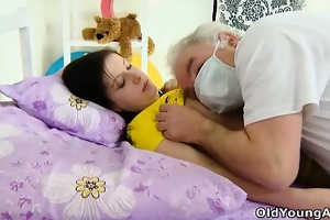 alena is laying in bed, looking hot in her yellow