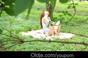 old perv copulates a fiery redhead in the forest