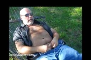 bushy dad bear jerking off on a sunny day